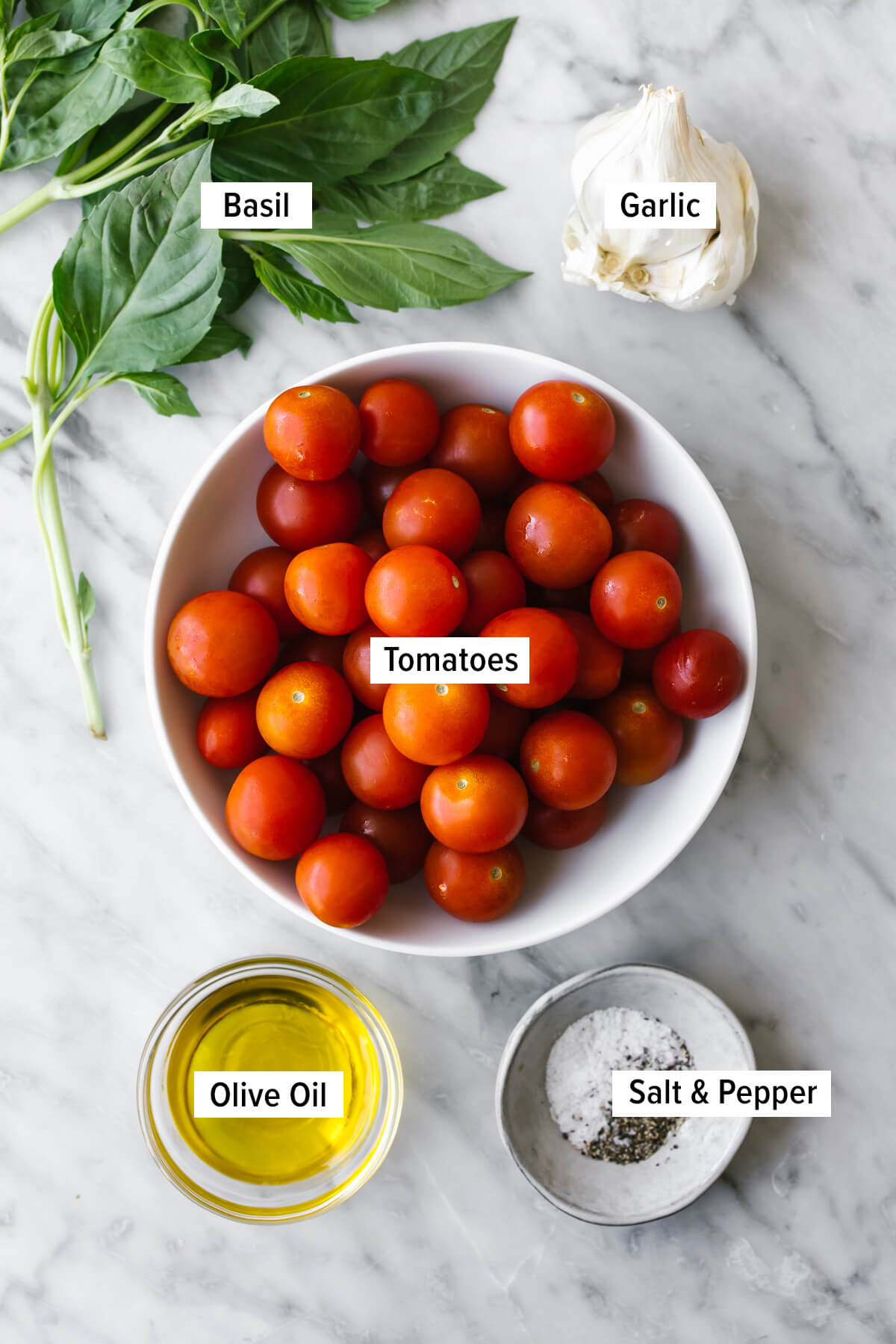 Ingredients for blistered tomatoes on a table.