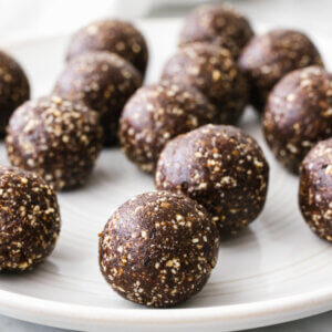 A white plate of mint chocolate energy balls.